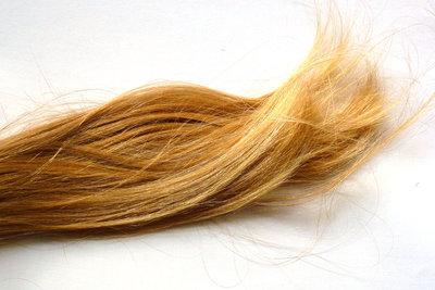 Anti-Locken-Shampoos sorgen für schönes glattes Haar.