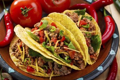 Die harten Taco-Schalen sind eine amerikanische Erfindung und Bestandteil der Tex-Mex-Küche.