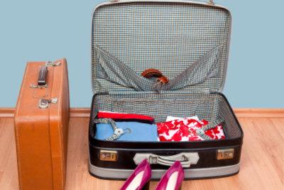 Auch Schuhe müssen in den Koffer.