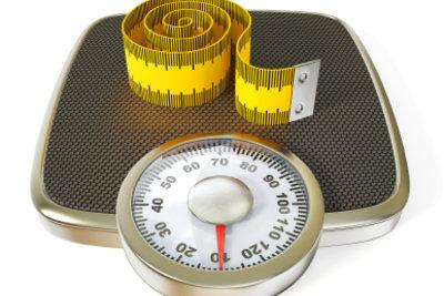 Eine Waage misst Ihr Gewicht.