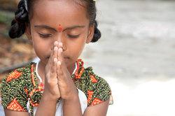 Das Beten haben Christentum und Hinduismus gemein.