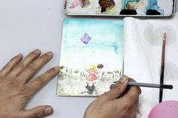Der Illustrator gestaltet Bilder.
