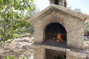 Ein gemauerter Grill kann mit Ytong selbst gebaut werden.