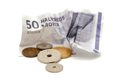 Wenn man nach Dänemark reist, sollte man etwas Geld in dänische Kronen wechseln.