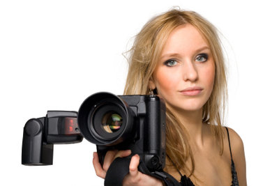 Schöne Fotos für den Personalausweis bekommt man beim Fotografen.