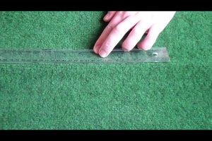 Falten im Teppich glätten - so funktioniert's