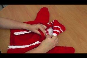 Babyjacke mit Kapuze stricken - so geht's