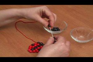 Perlentiere - Anleitung für einen Marienkäfer