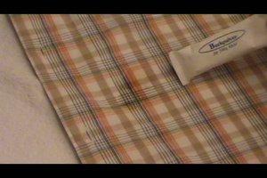 Kerzenwachs aus Kleidung und Textilien entfernen