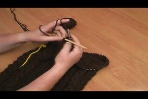 Loop-Schal stricken - eine Anleitung mit Zopfmuster
