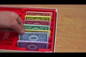 Monopoly-Anleitung - wie das Geld verteilt werden sollte