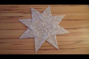 Sterne aus Transparentpapier basteln - Anleitung