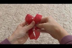Schöne Schleifen binden - Anleitung für Geschenkschleifen