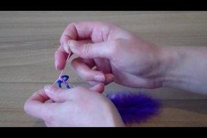 Federschmuck - so basteln Sie einen Kettenanhänger